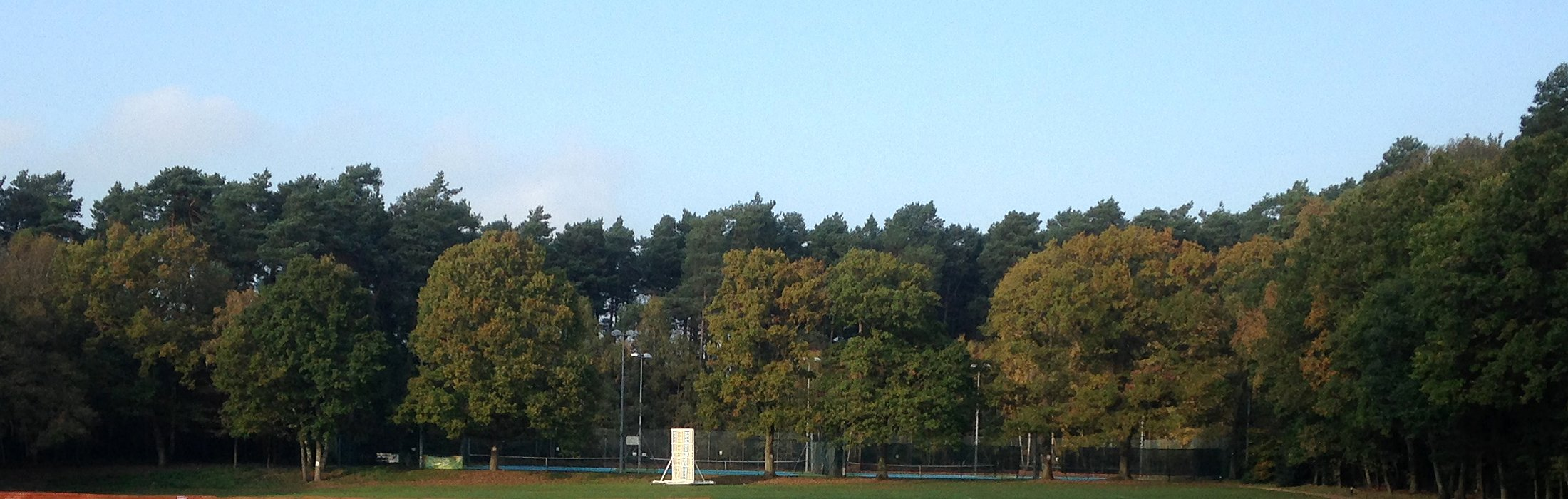 View of Crowthorne Tennis Club from across the cricket ground